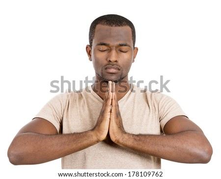 Closeup portrait of happy handsome, young man in meditation yoga mode, isolated on white background. Stress relief techniques concept. Positive human emotions, facial expression feelings signs symbols - stock photo
