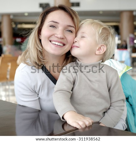 Closeup portrait of happy  mother with little son. - stock photo