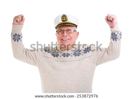 Closeup portrait of happy old senior man with a smile and white teeth,  raised his hands up, boat captain cap, isolated on white background - stock photo