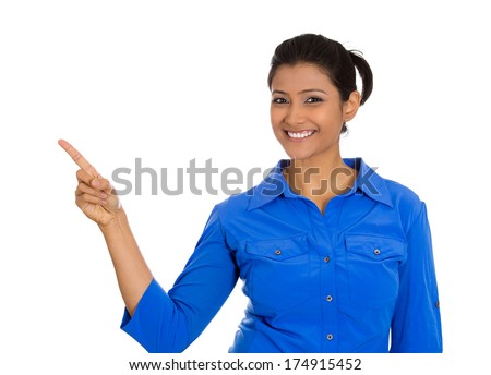 Closeup portrait of happy pretty confident young smiling woman gesturing pointing to space at left isolated on white background. Positive human emotion signs symbol, facial expression feelings - stock photo