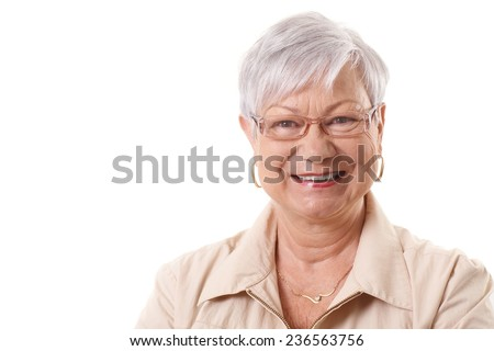 Closeup portrait of happy smiling elderly lady, looking at camera. - stock photo