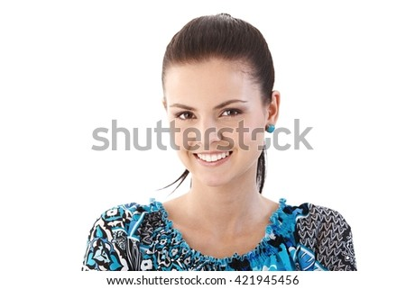 Closeup portrait of happy young woman smiling, looking at camera. - stock photo