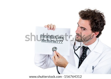 Closeup portrait of health care professional, dr or md with stethoscope listening to the sign that says healthcare reform ???, isolated on white background. Obamacare debate - stock photo