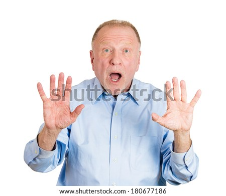 Closeup portrait of helpless senior mature man raising hand up to say no stop right there, isolated on white background. Negative emotion facial expression feelings, signs symbols, body language - stock photo