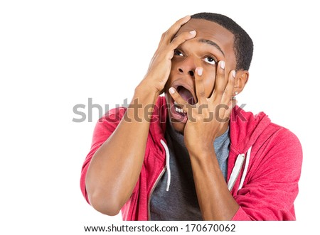 Closeup portrait of hysterical mad man going nuts seeing things that don't exist hallucination and being confused, isolated on white background. Negative human emotion facial expressions feeling - stock photo