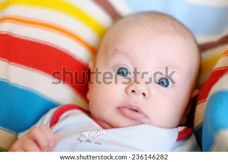 Closeup portrait of little funny baby boy - stock photo