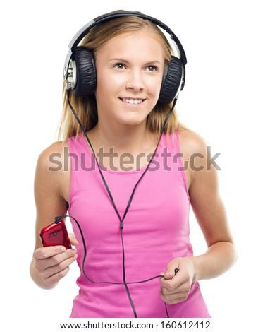 Closeup portrait of lovely teen girl enjoying music using headphones, isolated over white - stock photo
