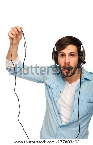 Closeup portrait of male customer service representative or call centre worker or operator or support staff with wire in hands, no connection on white background - stock photo