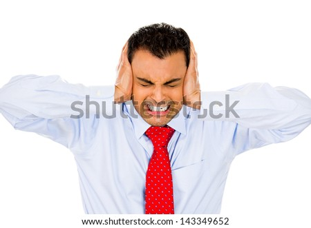 Closeup portrait of man holding hands to ears covering to shut out noise, isolated on white background - stock photo