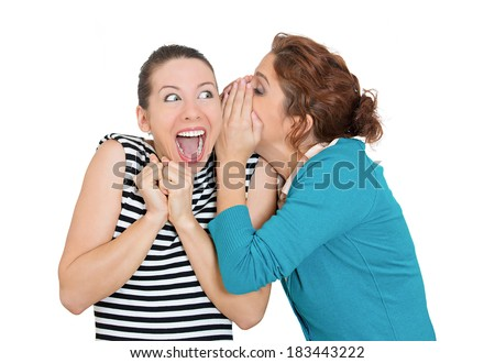 Closeup portrait of man whispering into woman's ear telling her something secret good news. Happy smiling cheerful toothy response. Positive communication human emotions facial expression feelings