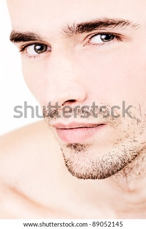 closeup portrait of man, young handsome male model, attractive, smiling and charmin, looking seductively - made in studio on white background - stock photo