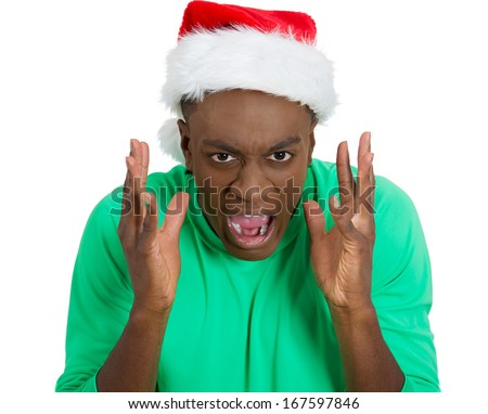 Closeup portrait of mean, mad guy, stressed man in red santa claus hat, yelling, very annoyed, unhappy, isolated on white background. Human emotion, facial expression, feelings, attitude, personality - stock photo