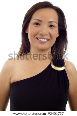 Closeup portrait of middle aged Asian woman isolated over white background