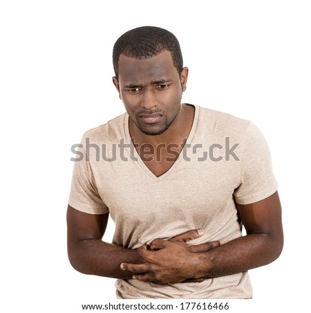 Closeup portrait of miserable, upset, ill, unhealthy, young man, doubling over in stomach pain, looking very sick unwell isolated on white background. Facial expressions emotion reaction health issues - stock photo