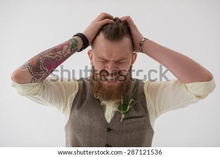 Closeup portrait of modern groom looking nervous before his wedding - stock photo