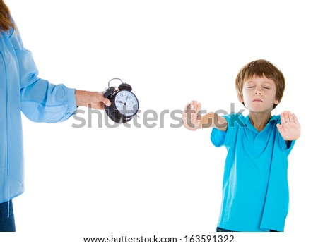 Closeup portrait of mom showing kid clock that it is time to go to bed. He doesn't like that, puts hands up in air and says no stop. Isolated on white background, Negative  emotion facial expressions - stock photo