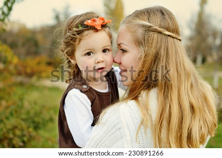 Closeup portrait of mother and daughter - stock photo