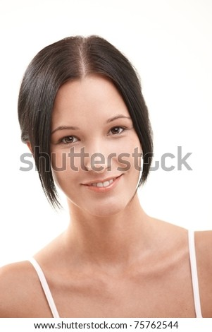 Closeup portrait of natural looking young woman smiling at camera. - stock photo