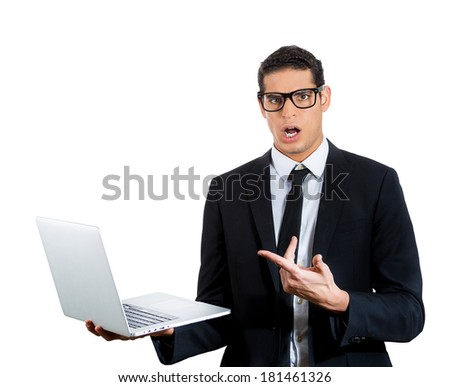 Closeup portrait of nerdy young man shocked in disbelief by what he sees on his personal silver laptop, isolated white background. Negative human emotion facial expression feelings. Internet nightmare - stock photo