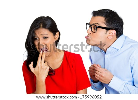 Closeup portrait of nerdy young man with big black glasses trying to kiss snobby woman who is gross disgusted and sticks finger in mouth, isolated white background. Negative emotion facial expression - stock photo