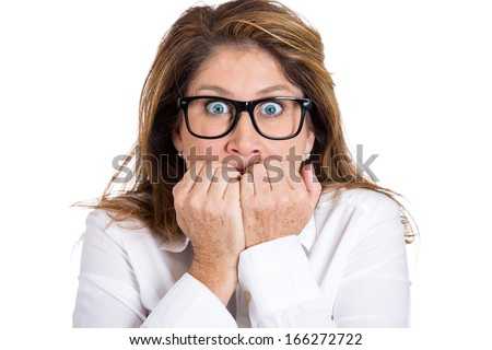 Closeup portrait of nervous, stressed young woman, girl with eyeglasses biting fingernails looking anxiously, craving for something isolated on white background. Human emotions expressions, feelings - stock photo