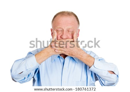 Closeup portrait of old man, senior citizen, worker, employee, covering his mouth, eyes closed Speak no evil concept, isolated on white background. Human emotions, face expressions, feelings, signs - stock photo