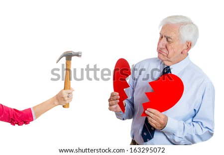 Closeup portrait of old man, senior executive, businessman, corporate employee, mature guy, having heart broken by someone with hammer, isolated on white background. Human emotions, expressions - stock photo