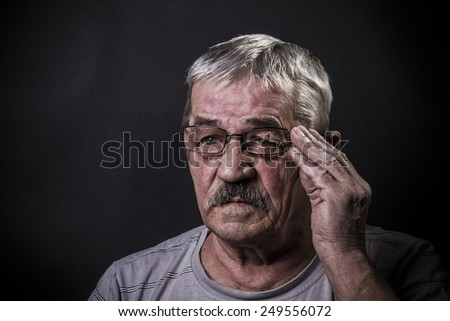 closeup portrait of old man with glasses - stock photo