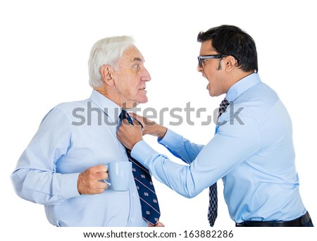 Closeup portrait of outraged angry worker employee grabbing surprised shocked coffee drinking senior older mature elderly boss by tie yelling screaming, isolated on white background. Office conflict - stock photo