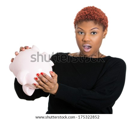 Closeup portrait of poor stressed, upset, sad, unhappy young woman holding empty piggy bank, debt, isolated against white background. Financial difficulties, bad economy concept. Negative emotion - stock photo