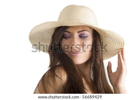 closeup portrait of pretty brunette woman wearing a nice summer hat with long hair