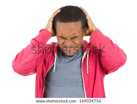 Closeup portrait of really stressed out young guy, handsome student with headache, having bad day at work, school, university, isolated on white background. Negative human emotions, facial expressions - stock photo