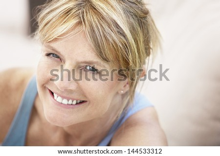 Closeup portrait of relaxed middle aged woman smiling - stock photo
