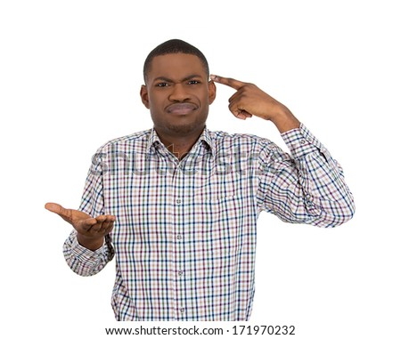Closeup portrait of rude difficult angry young man, gesturing with his finger against his temple, are you crazy? Isolated on white background. Negative human emotions, facial expression, feelings - stock photo