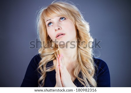 Closeup portrait of sad troubled, melancholic, funny looking young woman praying, hopes, asks, begs for best, having tough times in life isolated grey background. Emotion, facial expression, feeling