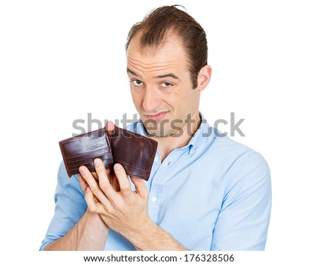 Closeup portrait of sarcastic, surprised, funny looking business man, worker, employee holding empty wallet showing hole in his budget, isolated on white background. Bankruptcy financial difficulties - stock photo