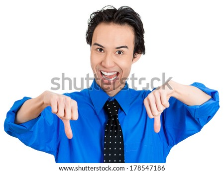 Closeup portrait of sarcastic young man showing two thumbs down sign hand gesture, happy that someone made a mistake or lost, isolated white background. Negative emotion facial expression feelings