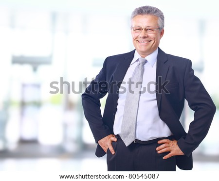Closeup portrait of satisfied mature businessman in his office with copy space - stock photo