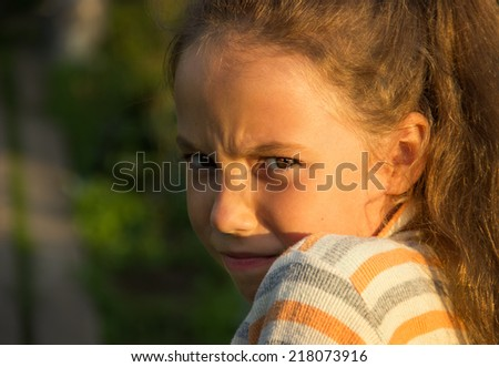 Closeup portrait of Scared and angry cute little girl. Domestic violence concept.  - stock photo