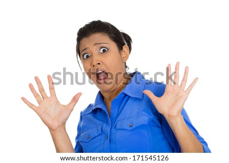 Closeup portrait of scared woman raising hands up in defense, afraid about to be attacked or avoiding an unpleasant situation, isolated on white background. Negative emotion facial expression feelings - stock photo