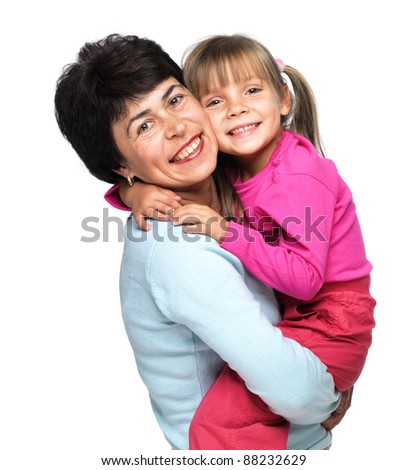 Closeup portrait of senior Caucasian woman with little granddaughter