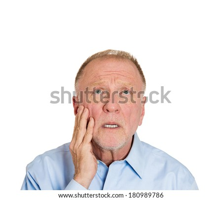 Closeup portrait of senior elderly mature depressed man really sad, deep in thought, looking up asking question why me? isolated on white background. Human face expressions, emotion, feeling, reaction - stock photo