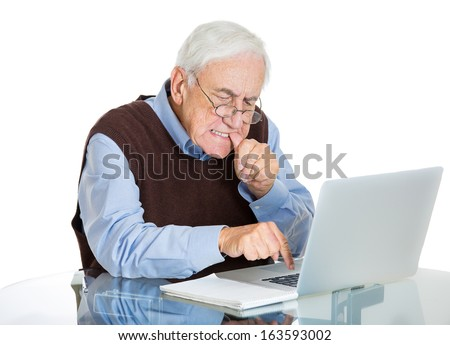 Closeup portrait of senior elderly mature man with glasses biting finger nails trying to type on laptop, isolated on white background. Human emotions and facial expressions. Age related changes.