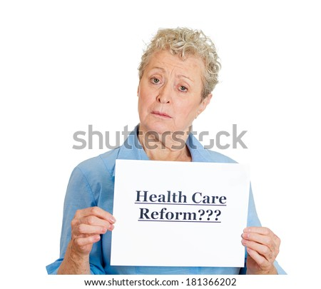 Closeup portrait of senior mature confused skeptical woman holding a sign health care reform, uncertain of universal insurance coverage, isolated white background. politics, government , legislation - stock photo