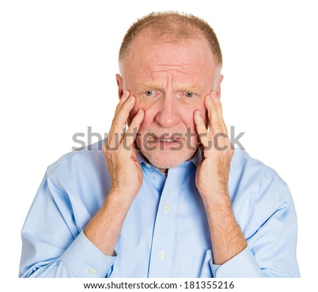 Closeup portrait of senior mature depressed man really sad, deep in thought, realizing truth looking down, hand on cheek, isolated on white background. Human face expression emotion feeling, reaction - stock photo