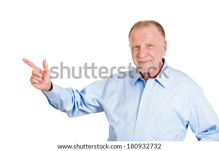 Closeup portrait of senior mature happy smiling business man, pointing with finger at copy space to left, isolated on white background. Positive emotions, facial expressions, corporate successful life - stock photo