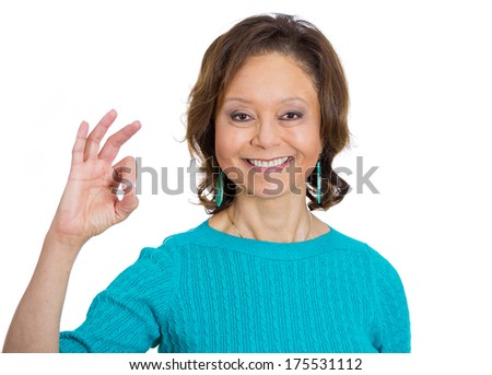 Closeup portrait of senior mature happy, smiling excited natural woman giving OK sign symbol with fingers, isolated on white background. Positive emotion facial expressions symbols, feelings attitude