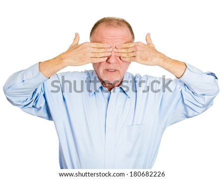 Closeup portrait of senior mature shy man closing covering eyes with hands can't see, hiding, isolated white background. See no evil concept. Negative human emotion facial expression feeling reaction - stock photo