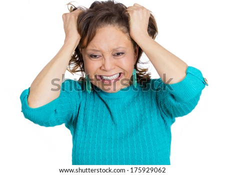 Closeup portrait of senior mature woman pulling out hair in frustration stress, about to have nervous breakdown, isolated white background. Negative emotion facial expression feelings, body language