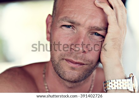 Closeup portrait of serious man looking at camera. - stock photo